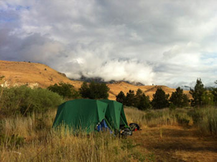 Tents on the Deschutes River during and overnight camp trip