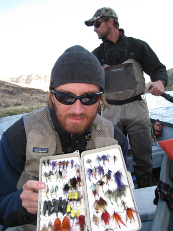 An angler with a selection of Deschutes River Steelhead Flies